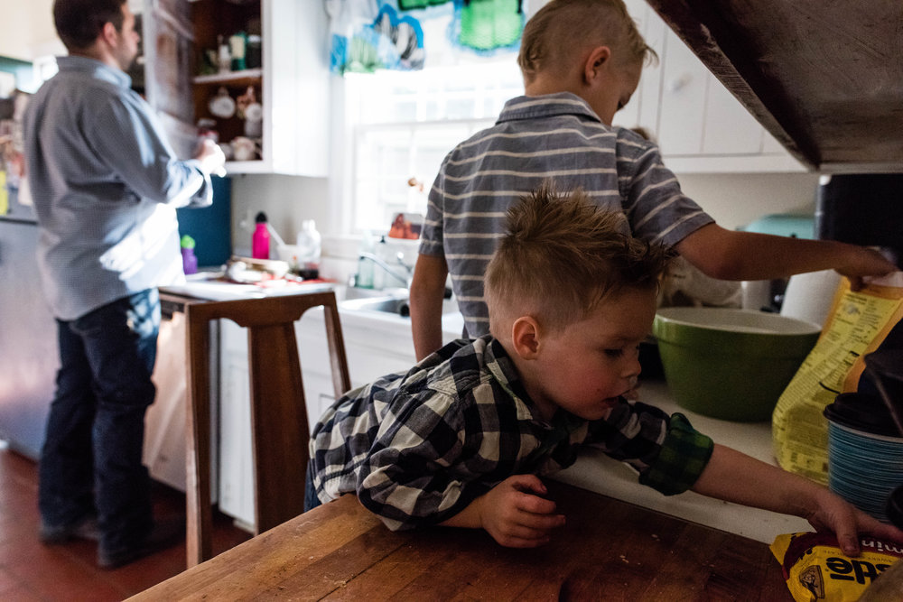 Boy sneaking chocolate by Northern Virginia Family Photographer