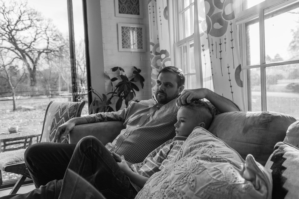 Father and Son watching soccer on TV by NOVA Family Photographer Nicole Sanchez