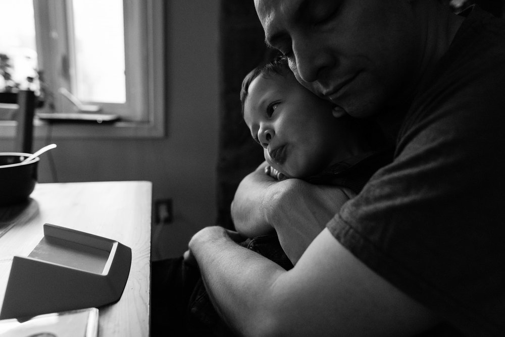 boy-making-silly-face-while-hugged-by-dad-by-Northern-Virginia-Family-Photographer-Nicole-Sanchez