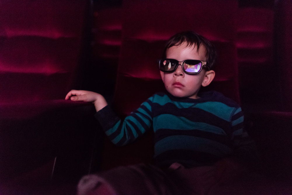 boy-watching-movie-3d-glasses-theater-by-Northern-Virginia-Family-Photographer-Nicole-Sanchez.jpg