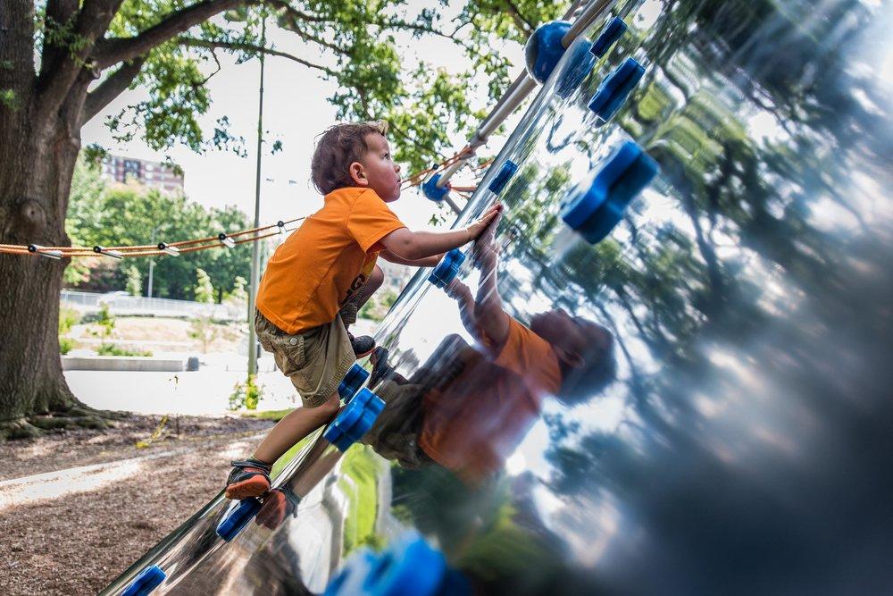boy climbing at rocky run park in arlington virginia