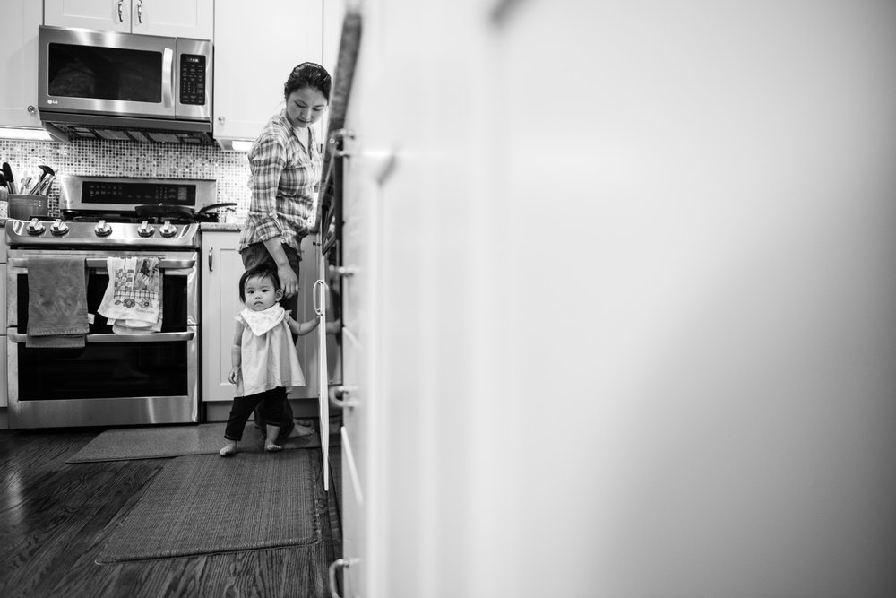 Toddler girl in kitchen with mom in Springfield, VA by Family Photographer Nicole Sanchez