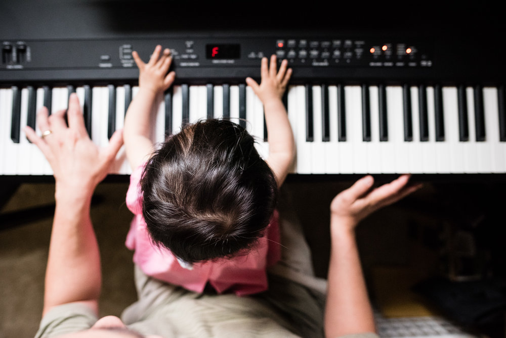 Girl playing piano with Dad in Northern Virginia by Family Photographer Nicole Sanchez