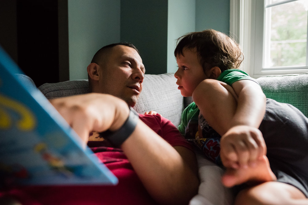 Father and son discussing book in Northern Virginia by family photographer Nicole Sanchez