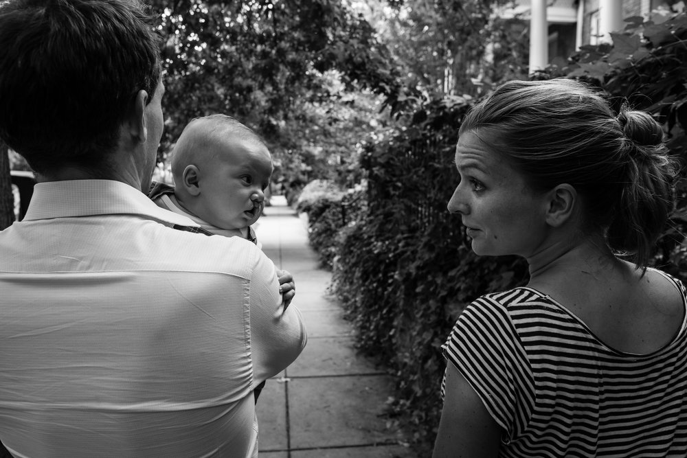 Mom looking at baby boy while on a walk in Washington, DC by Family Photographer Nicole Sanchez