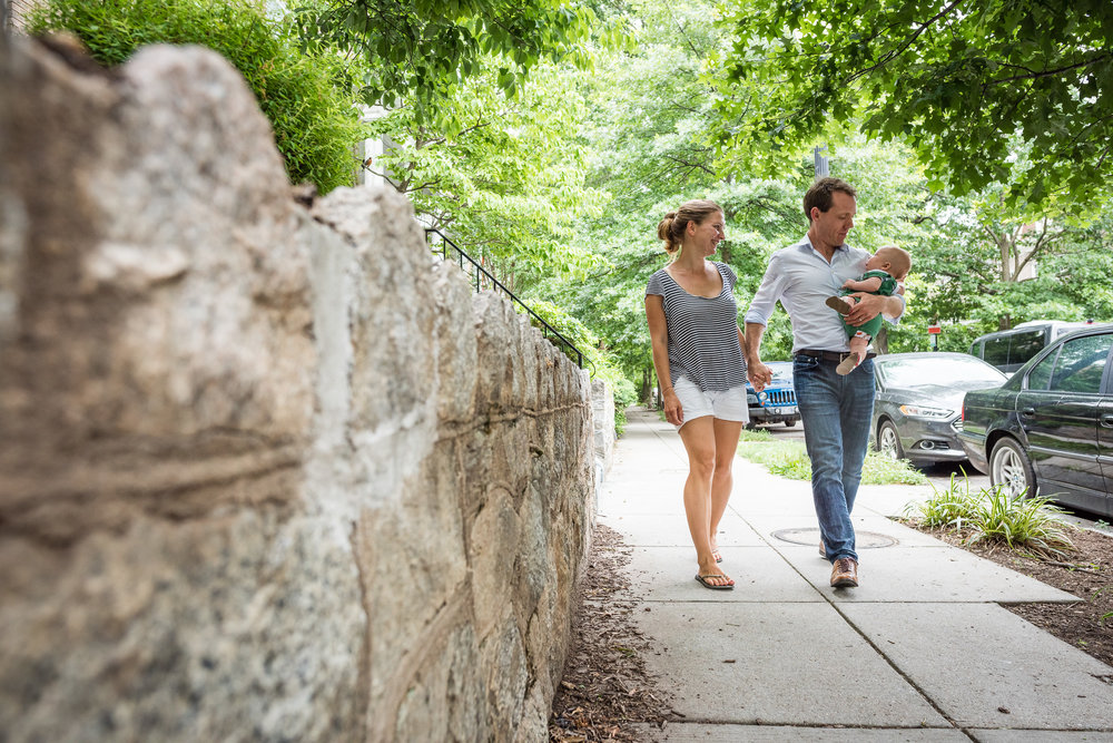 Family on a walk with baby in Washington, DC by Lifestyle Photographer Nicole Sanchez