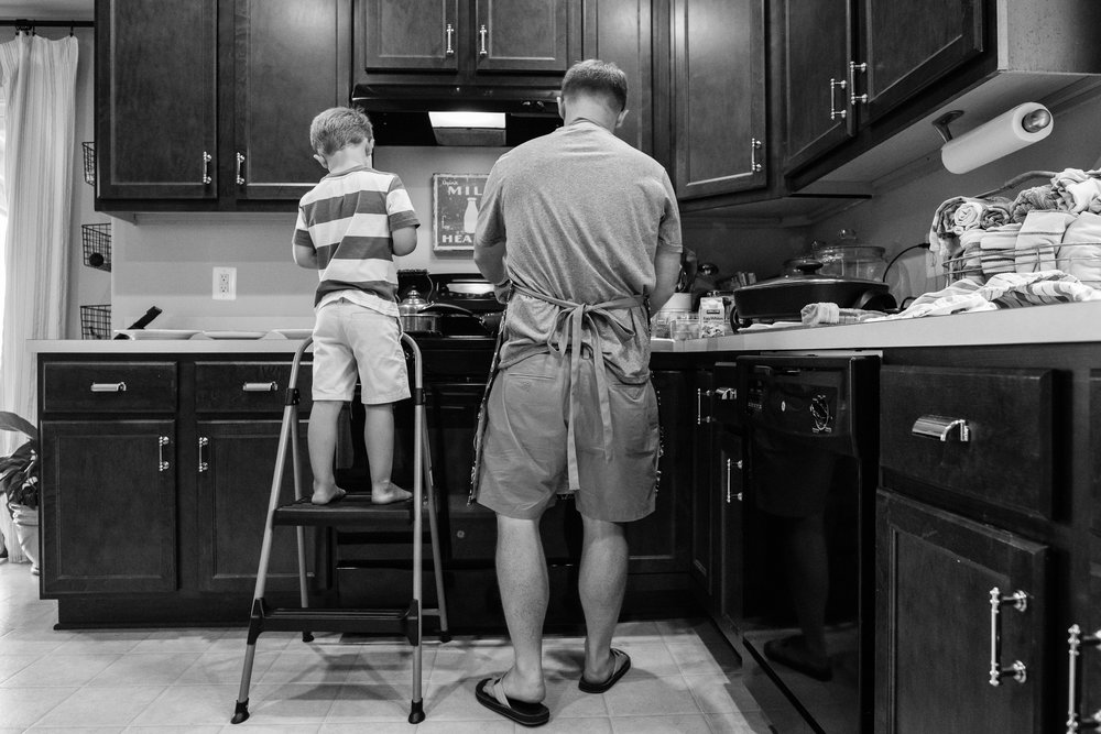 Father and son cooking breakfast in home by Northern Virginia Family Photographer Nicole Sanchez