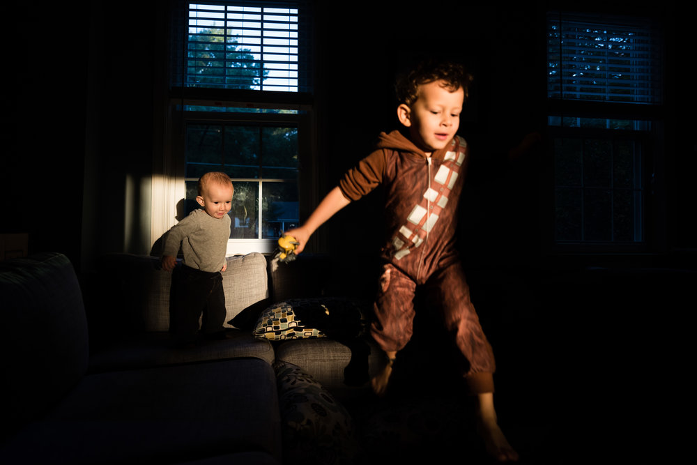 boy dressed as chewbacca jumping on couch by northern virginia family photographer nicole sanchez