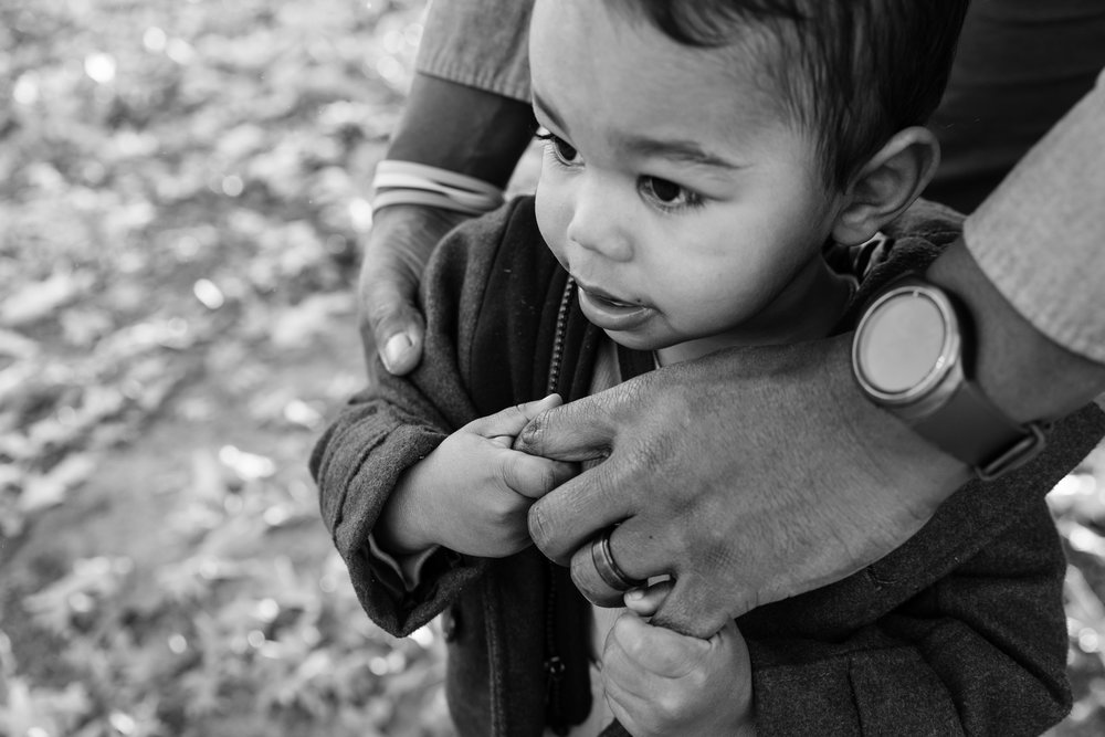 Son shyly holding on to father's hand