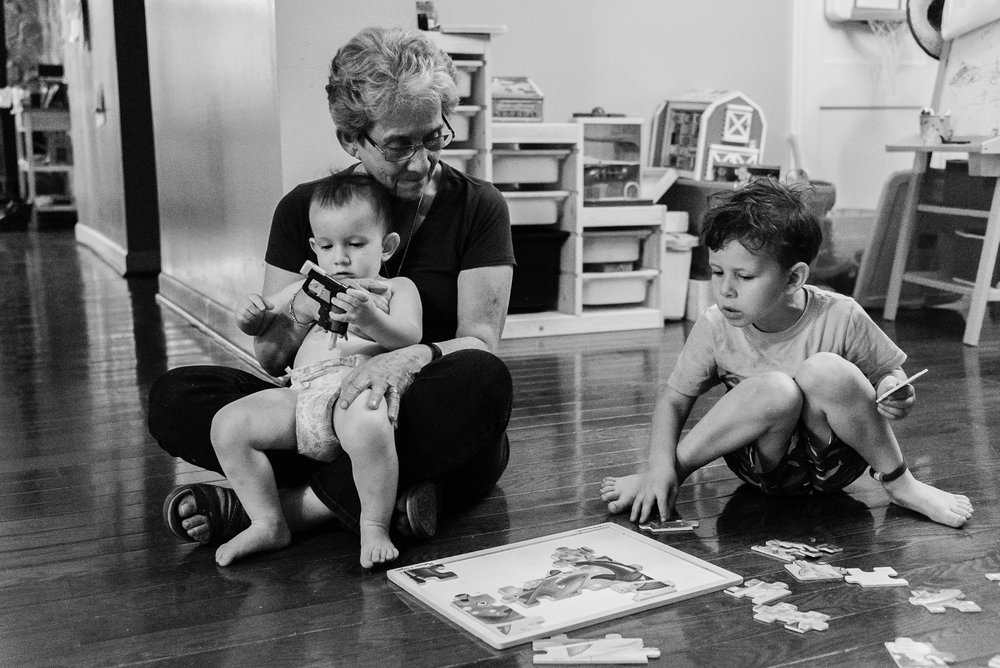 Grandmother playing game with grandsons by Northern Virginia Family Photographer Nicole Sanchez