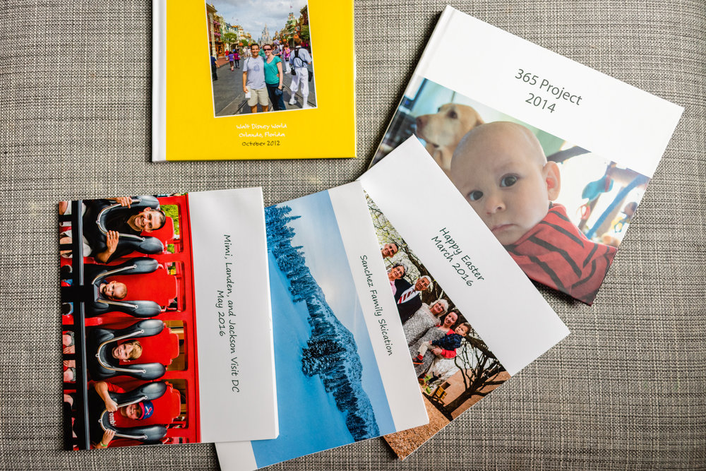 Variety of family photo books by Northern Virginia Family Photographer Nicole Sanchez