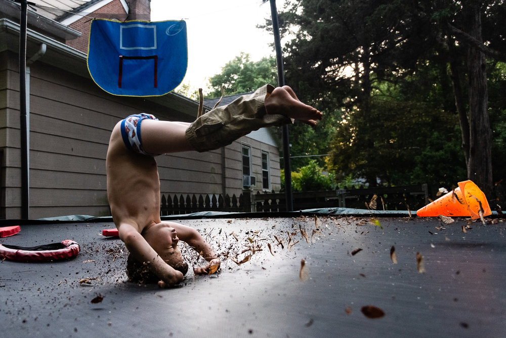 Boy flipping on trampoline in Northern Virginia by Family Photographer Nicole Sanchez
