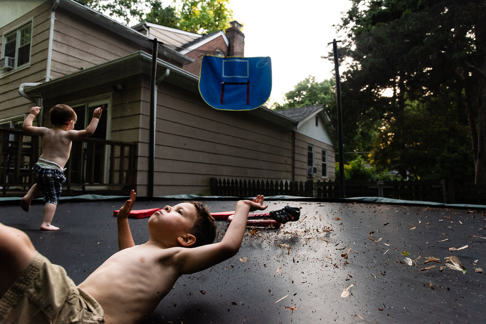Brothers jumping on trampoline by Northern Virginia Family Photographer Nicole Sanchez