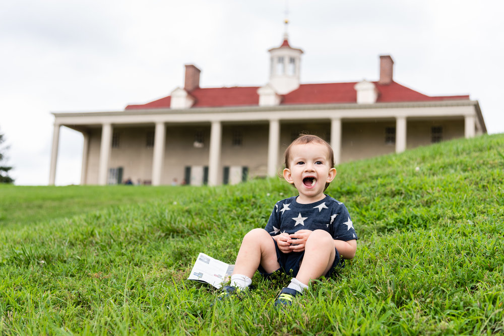 Toddler resting in front of Mount Vernon Estate in Alexandria by Northern Virginia Family Photographer Nicole Sanchez