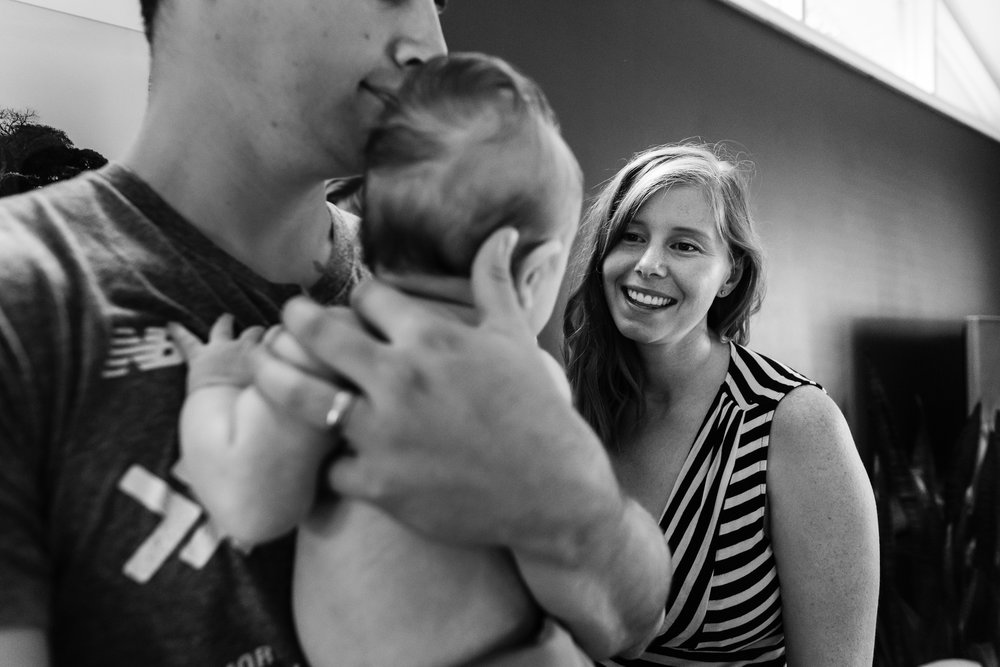 New mother smiling at baby by Northern Virginia Family Photographer Nicole Sanchez