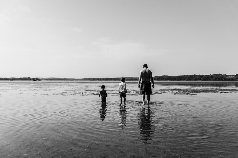 Father and sons wading in river at Mason Neck State Park by Northern Virginia Family Photographer Nicole Sanchez