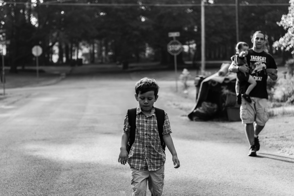 Boy walking to school with dad and baby brother in Northern Virginia by Family Photographer Nicole Sanchez