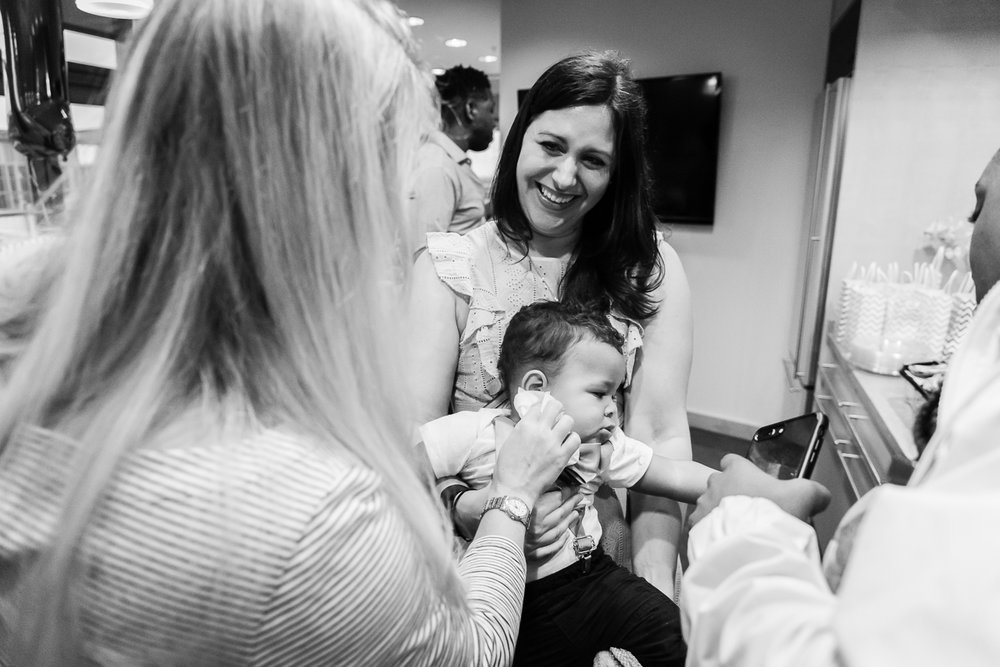 Family helping clean cake off baby by Northern Virginia Photographer Nicole Sanchez