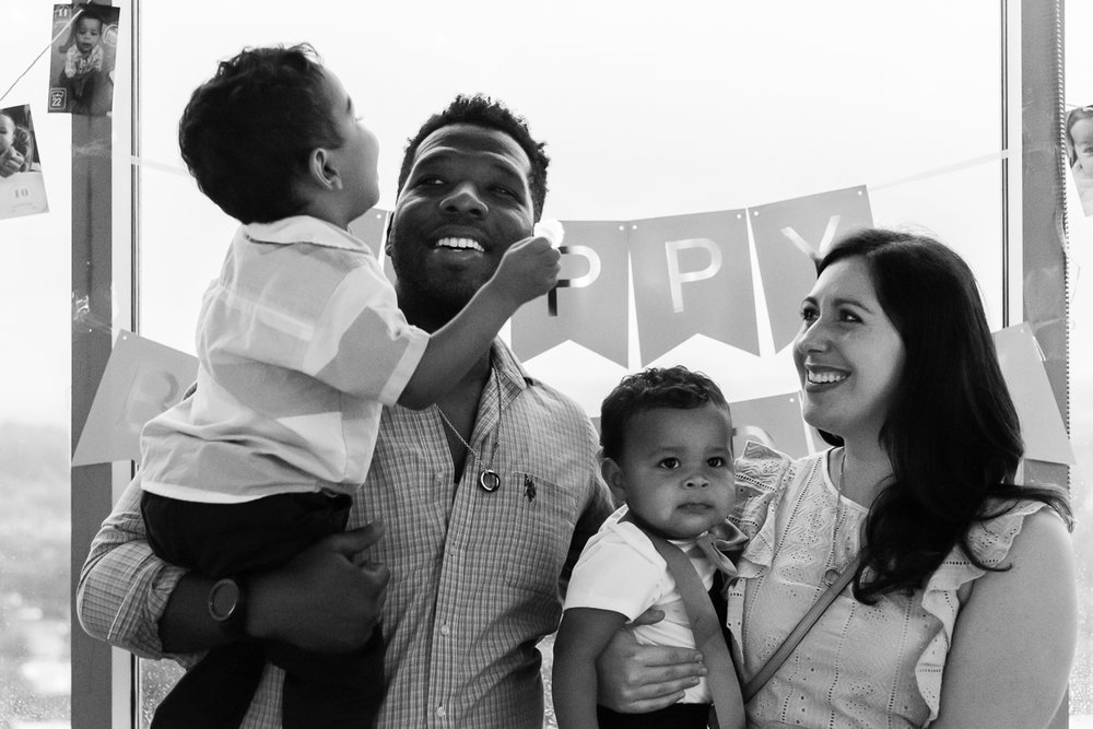 Mom and dad laughing with their kids at birthday party by Northern Virginia Family Photographer Nicole Sanchez