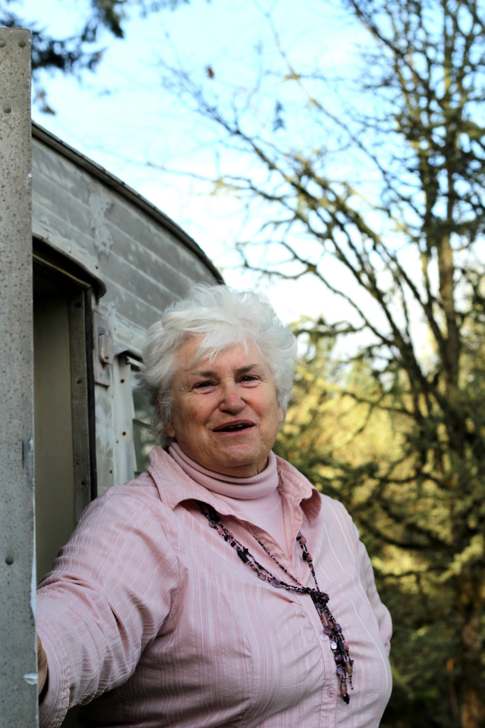 Carrol Crawford stands outside her trailer that she lives in full time.