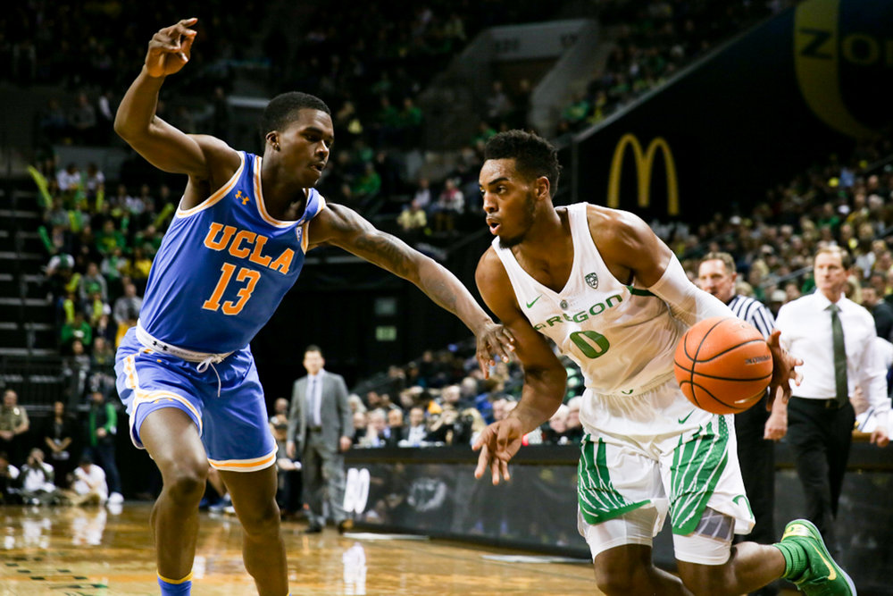 Ducks forward Troy Brown dodges a UCLA Bruin. Oregon basketball plays the UCLA Bruins at Matthew Knight Arena in Eugene, Ore. on Jan. 20, 2018. (Natalie Waitt-Gibson/Emerald)