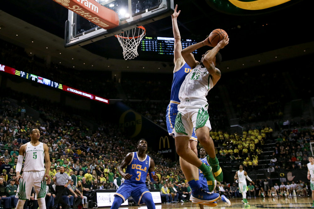 Ducks forward Paul White goes in for a dunk. Oregon basketball plays the UCLA Bruins at Matthew Knight Arena in Eugene, Ore. on Jan. 20, 2018. (Natalie Waitt-Gibson/Emerald)