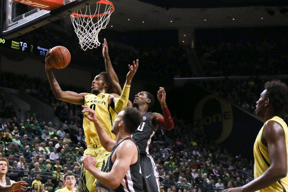Oregon forward Troy brown dunks the ball. Oregon basketball take on the Washington State Cougars at Matthew Knight Arena in Eugene, Ore. on Feb. 11, 2018. (Natalie Waitt-Gibson/Emerald)