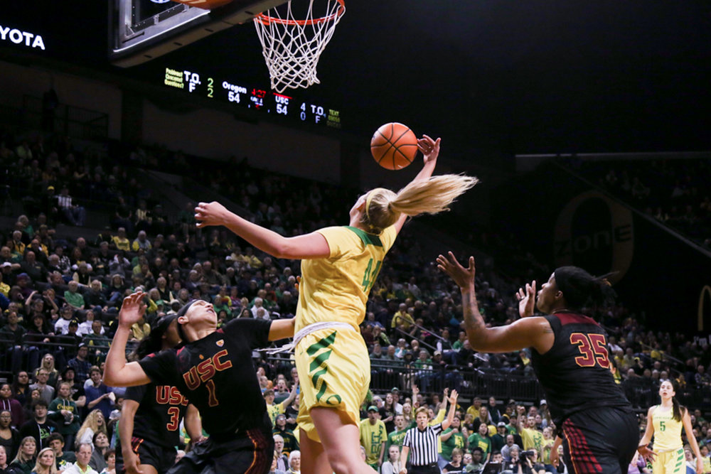 Forward Mallory McGwire (44) rebounds the ball. Oregon Women's Basketball win in double overtime against the University of Southern California Trojans. (Natalie Waitt-Gibson/Emerald)