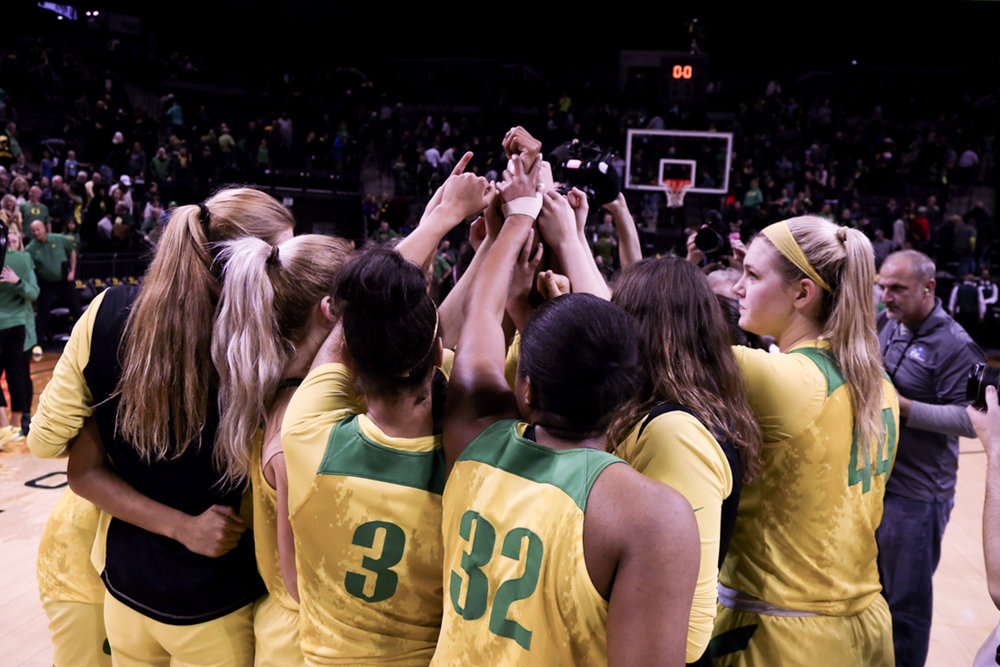 The Ducks huddle after their win.  Oregon Women's Basketball win in double overtime against the University of Southern California Trojans. (Natalie Waitt-Gibson/Emerald)