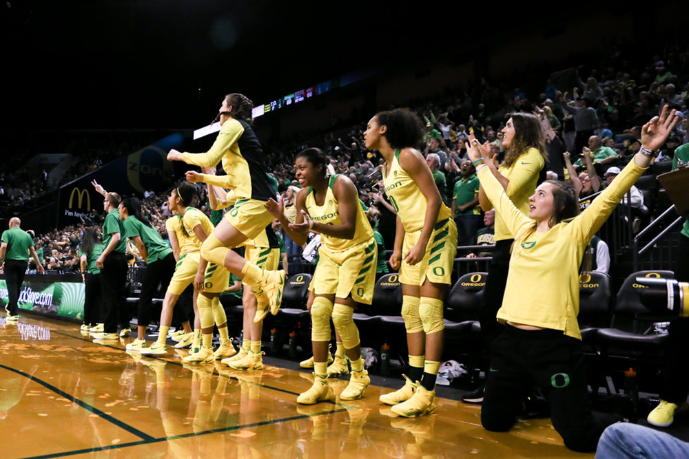 The Oregon Ducks cheer after a score. Oregon Women's Basketball win in double overtime against the University of Southern California Trojans. (Natalie Waitt-Gibson/Emerald)