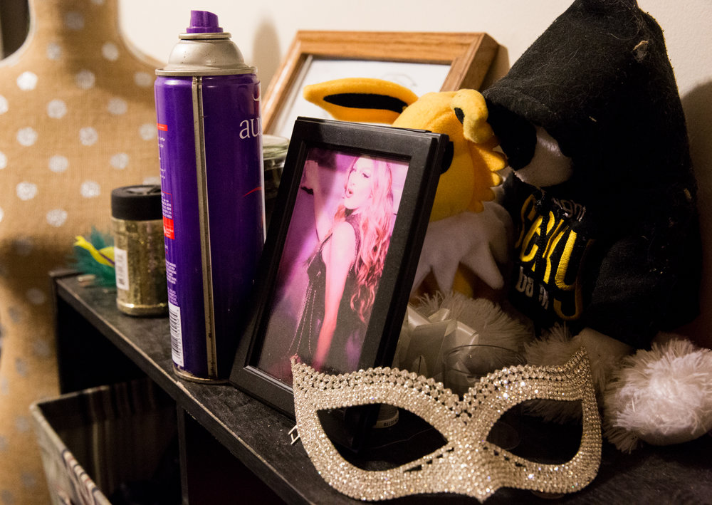 The dresser in Mark's drag room holds sentimental trinkets and mementos from past shows. The drag room is cluttered with things that Mark has collected throughout his five years of being a drag performer.