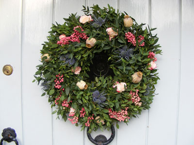 GO LUSH Bursting with glorious fresh foliage, spray roses, pepper berries, thistles, and dried poppy heads, the Winter Thorn wreath turns a door into an entrance. £60 www.willowandbloom.co.uk