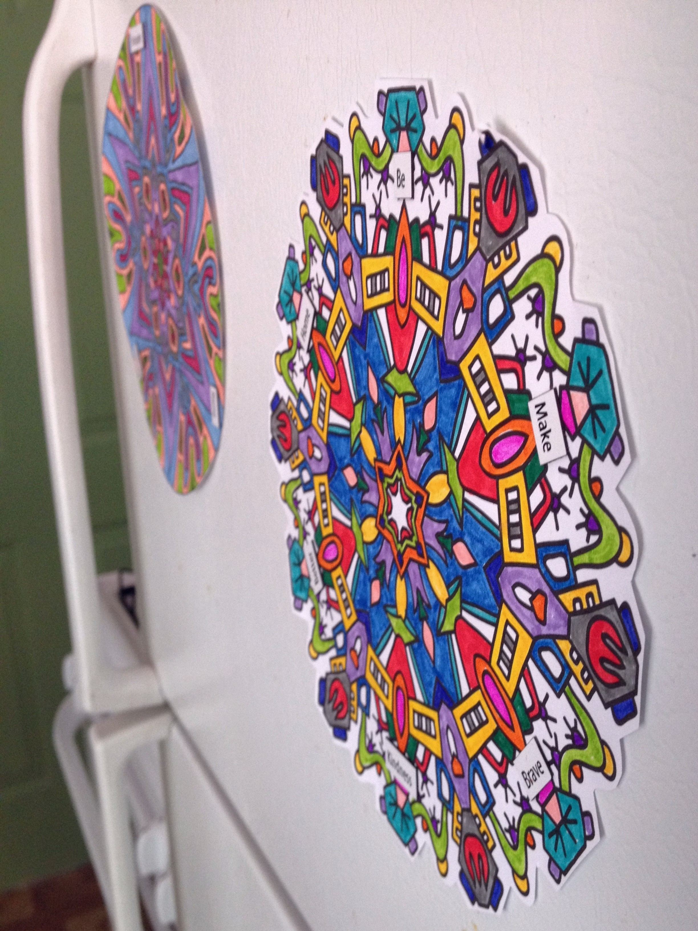colored mandalas on fridge