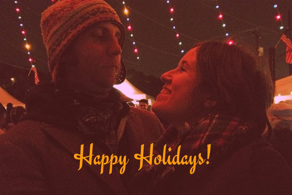 couple under zilker tree with Happy Holidays