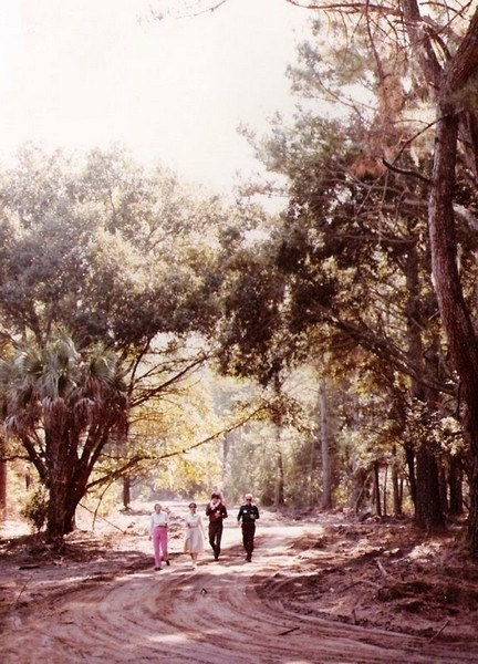 A group of early residents strolling down one of the first dirt roads in Long Cove Club.