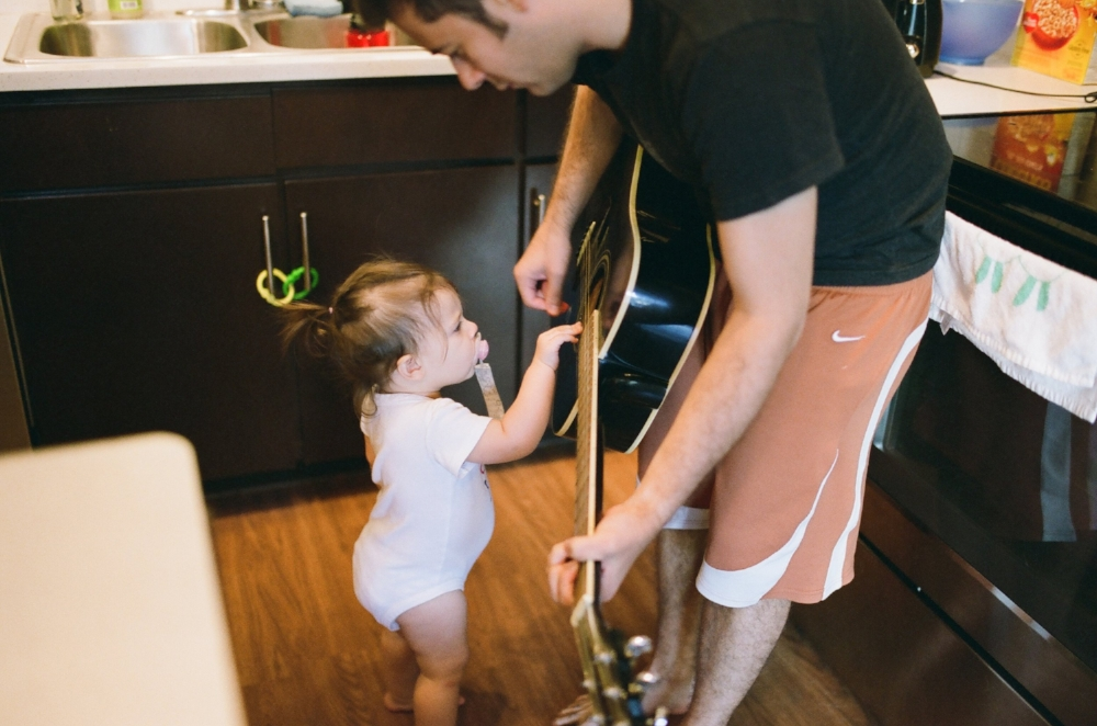 father and daughter playing the guitar together in Austin Texas