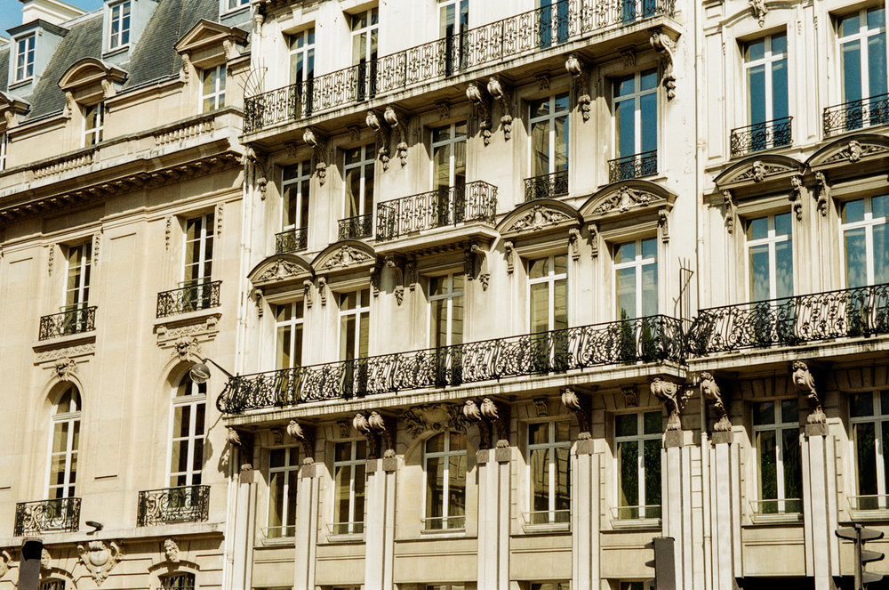 close up of a side of an old building with balconies, Paris France