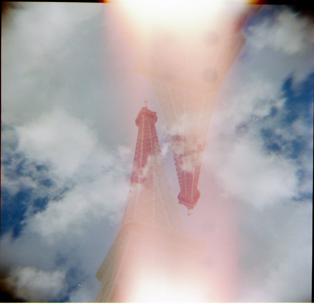 double exposure photo of the Eiffel Tower with a light leak