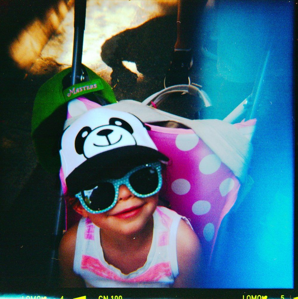 toddler in a Panda hat at the San deigo zoo film photo with light leak