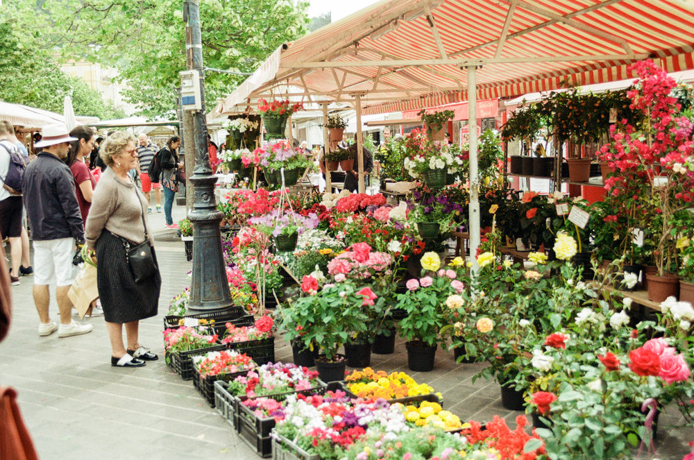 photo of flowers for sale at the farmers market in old town Nice, France