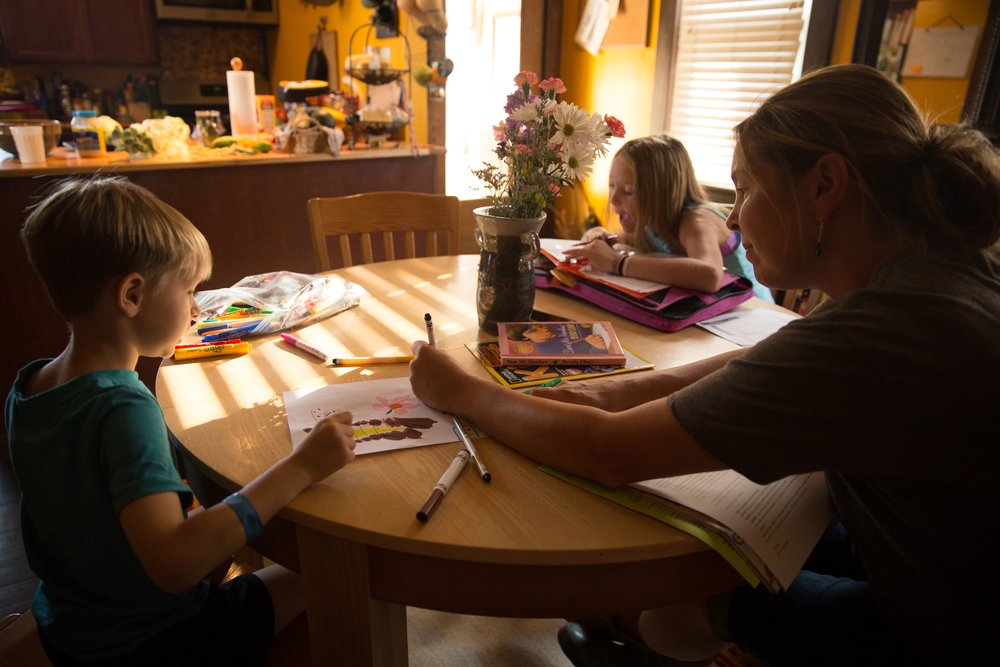 Jennifer L'Hereux helps her son Morris finish his doodles at their home in Nelsonville, Ohio. Jennifer frequently draws with her son after picking him up from school.