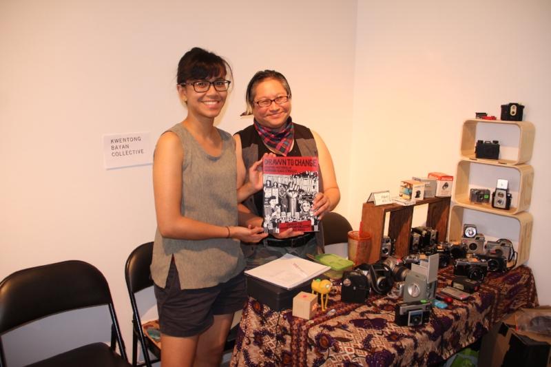 Althea Balmes & Jo SiMalaya Alcampo of Akin Lansdowne selling their comic, Drawn to Change at the Akin X Xpace Artist Garage Sale