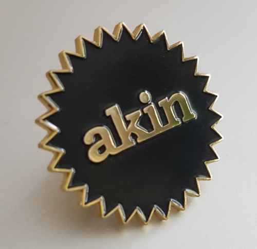 Limited edition enamel lapel pin released in celebration of AkinProjects.org -  Click here to buy
