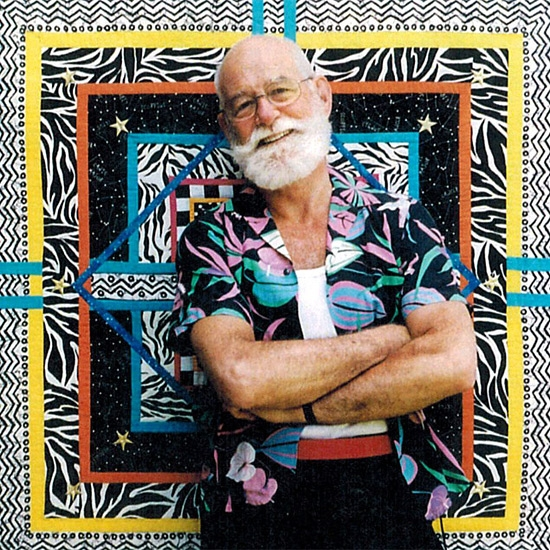 John Willard (1939-2014) in front of one of his quilts, 2014
