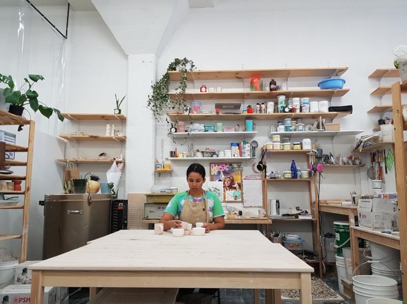 Artist Janet Hinkle working in her studio at Akin Ossington