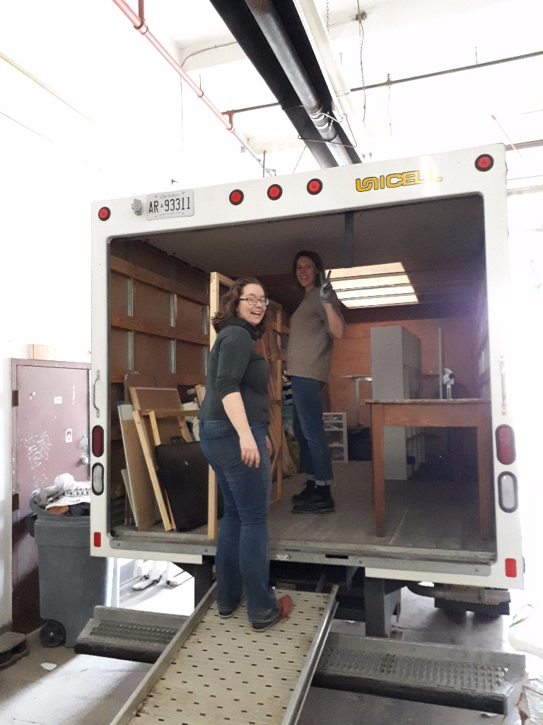 Akin artists Rebekah Andrade and Verity Griscti help load their studio supplies into Akin's moving trucks!