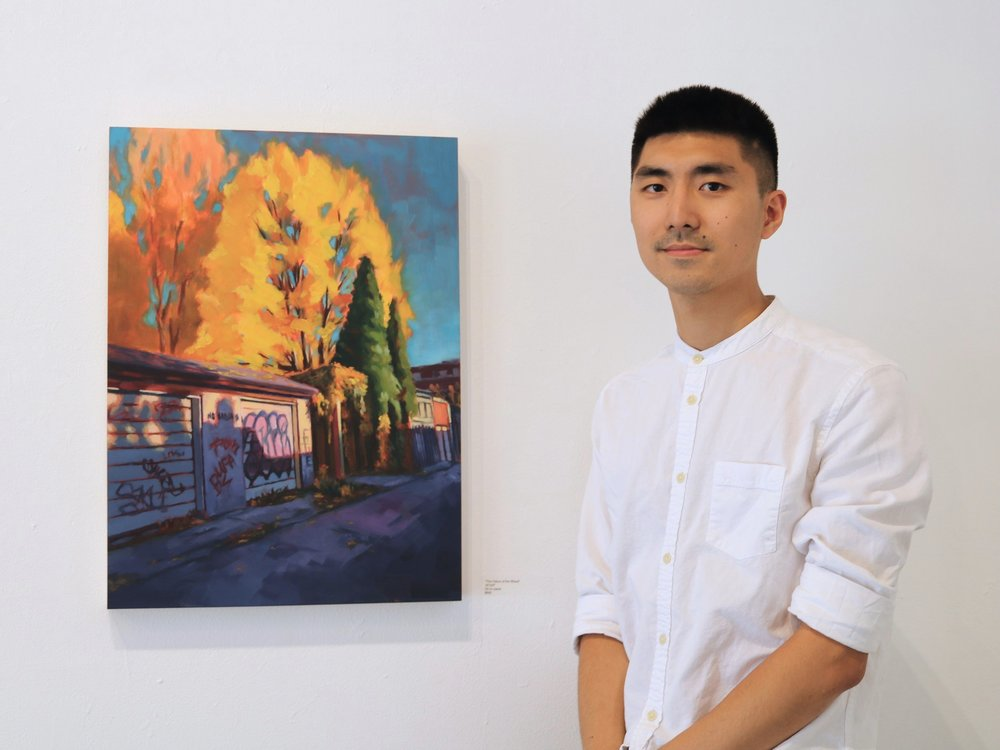 """Liang Wang beside his painting  The Colour of the Wheat , 2017, Oil on panel, 18"""" x 24"""""""