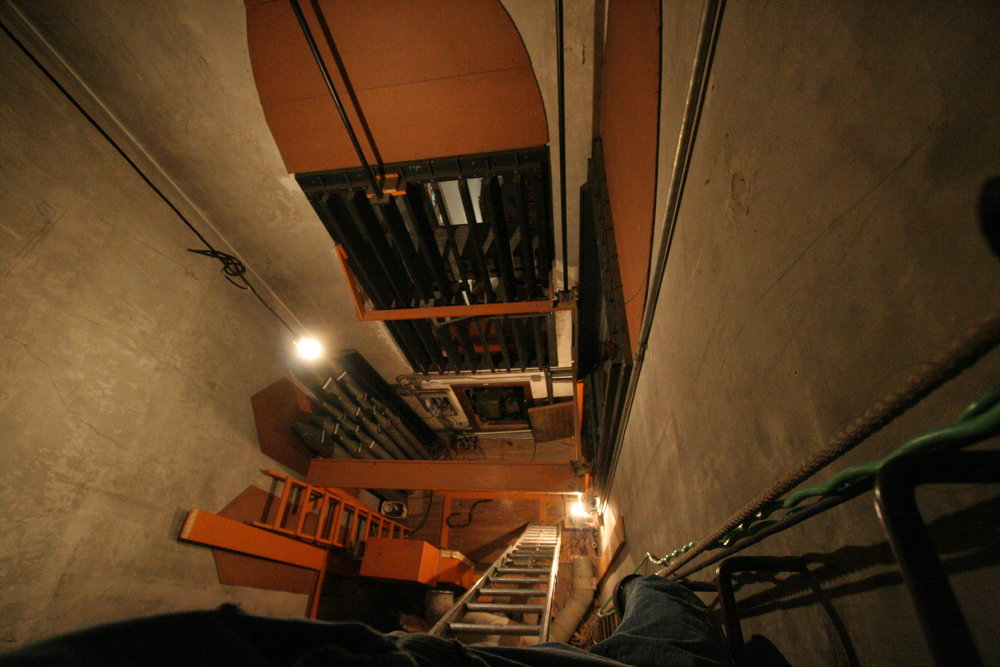 Scary view down from top of ladder  in swell chamber, not a place for the faint of heart.  This space will be full of pipes and mechanicals in a few months.
