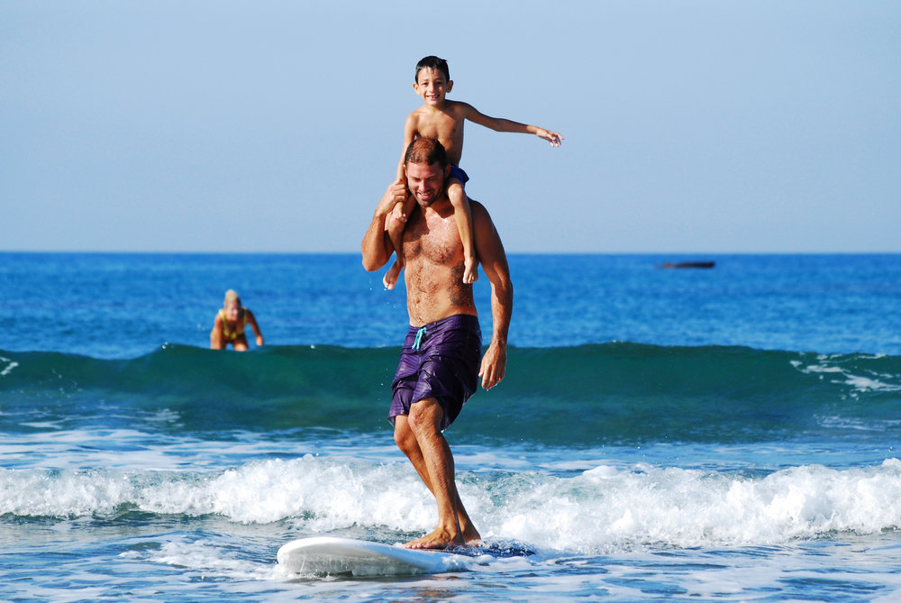 My oldest brother use to lift me onto his shoulders when we were surfing in Lorne just like this photo - great memory.