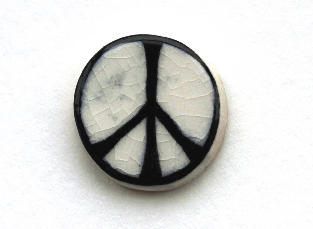 An original CND ceramic badge via http://www.cnduk.org/about/item/435-the-cnd-symbol